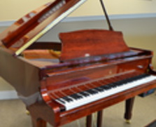 Story and Clark player baby grand