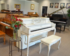 Antique white Sohmer console piano